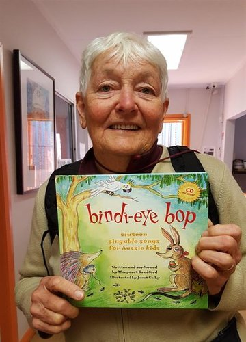 """Margaret Bradford pictured with her eco-friendly picture book and CD for kids """"Bindi-Eye Bop"""" Margaret is a teacher and a well-known folk singer and songwriter."""